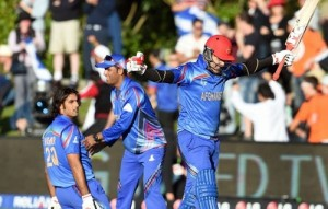 Afghanistan beat Scotland to win first cricket world cup match at Dunedin.