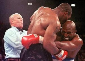 Mike Tyson bite Evander Holyfield ear in 1997 fight.