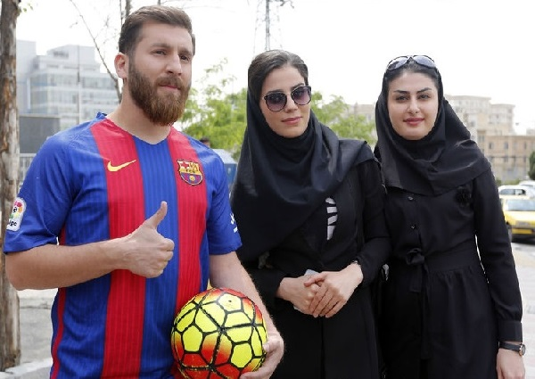 Iran's Reza Parastesh looks like Barcelona player Lionel Messi