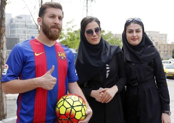 Iran's Reza Parastesh looks like Barcelona player Lionel Messi