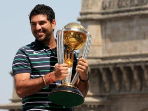 Yuvraj Singh holds 2011 world cup trophy